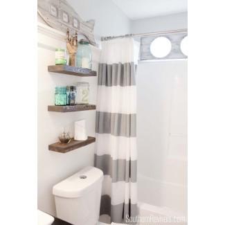 Opciones de diseño y almacenamiento sobre el inodoro para baños pequeños