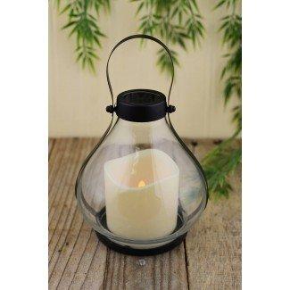 Linterna de metal y vidrio de la escuela con vela con pilas