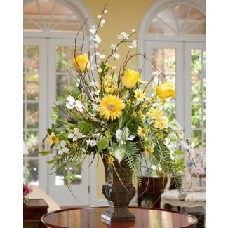 Jarrón de vidrio con flores artificiales