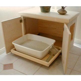 Mueble con caja de arena oculta