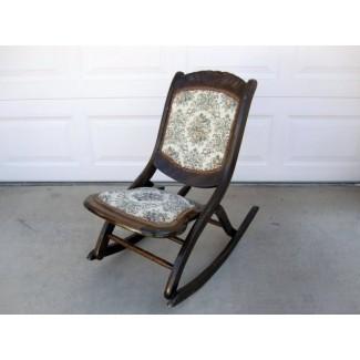 Mecedora plegable antigua de caoba con asiento estampado floral y