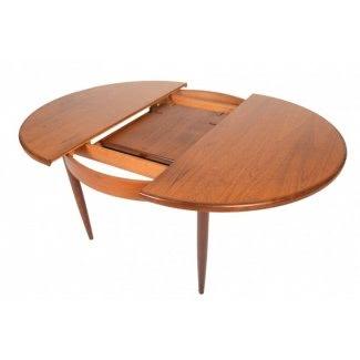 Mesa de comedor redonda con hoja de mariposa